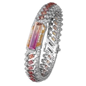 CARTIER Haute Joaillerie - Bracelet Magnitude de Cartier - Topaze Impériale bicolore rectangulaire (6,39 carats), saphirs taille baguette, quartz rutile, diamants.