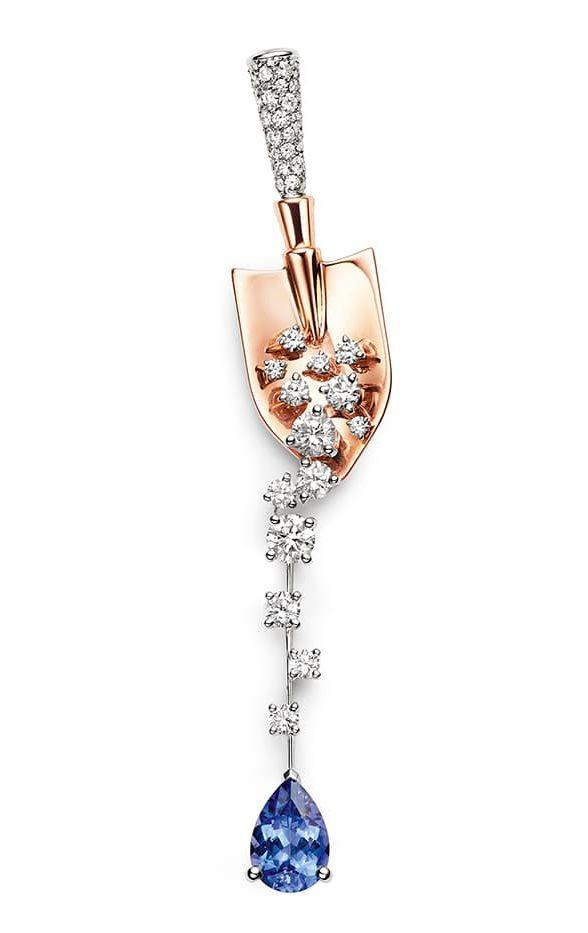 CHAUMET - Broche Terres de Trésors en or rose et or blanc, sertie d'une tanzanite taille ovale et de diamants taille brillant.